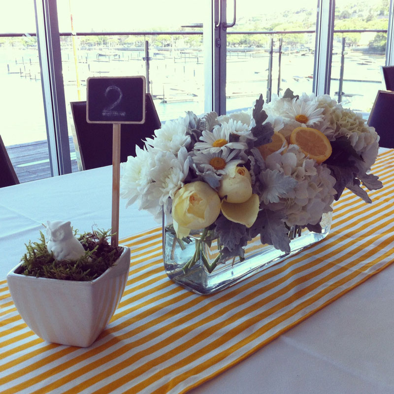 Yellow and white centrepiece with lemons